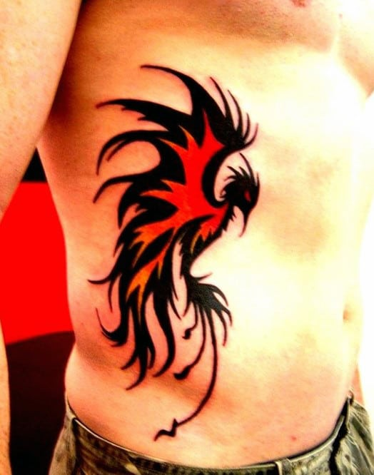Red And Black Ink Phoneix Tribal Bird Mens Rib Cage Side Tattoo