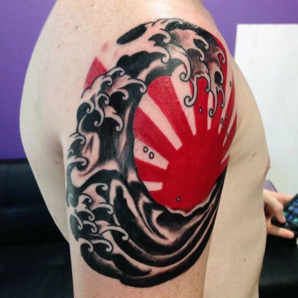 Red And Black Japanese Sun Tattoo For Guys On Upper Arm