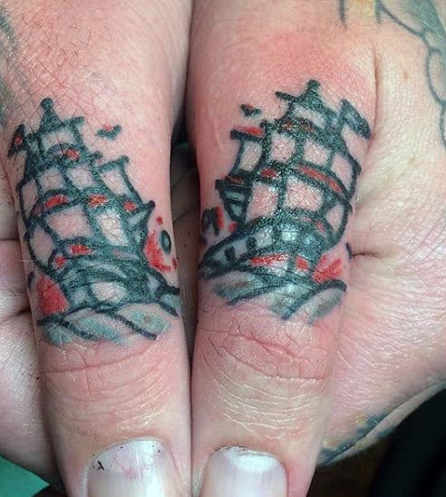 Red And Blue Sailing Ship Men Finger Tattoo