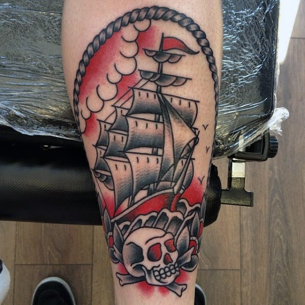 Red And Grey Ink Mens Skull With Ship Traditional Inner Forearm Tattoo