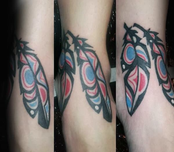 Red Blue Leafy Haida Tattoo Male Forearms
