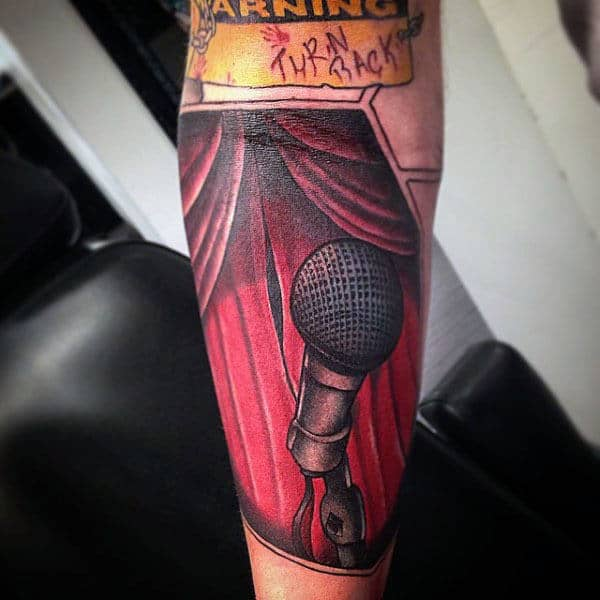 Red Curtained Dias And Microphone Tattoo Male Forearms
