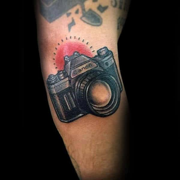 Red Glowing Canon Camera Tattoo Male Forearms