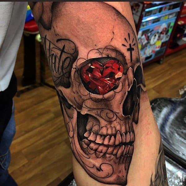 Red Heart Diamond Skull Eye Tattoo On Mans Arm