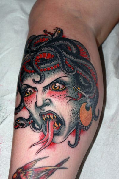 Red Ink Bicep Mens Medusa Tattoo