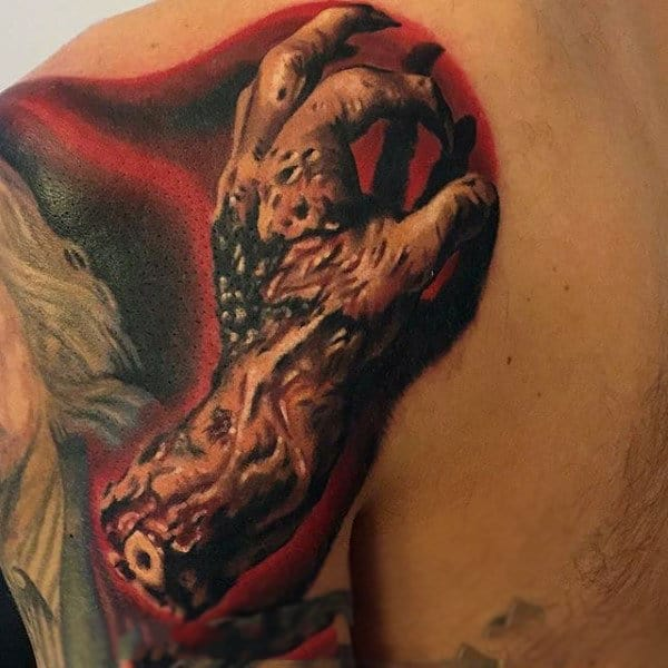 Red Ink Shaded Lifeless Zombie Hand Tattoo On Shoulder Of Male