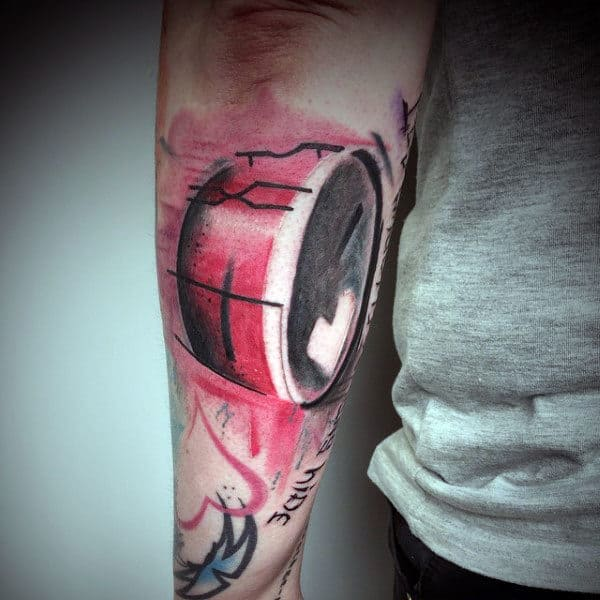 Red Ink Watercolor Guys Drum Forearm Tattoo