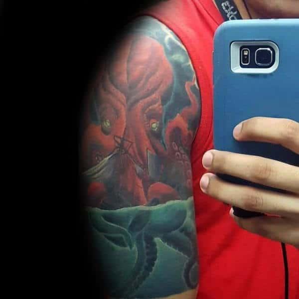 Red Kraken Floating In Blue Sea Water Mens Awesome Half Sleeve Tattoo