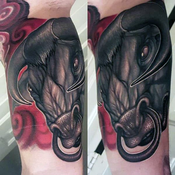 Red Matador Bull Tattoo On Man's Forearm