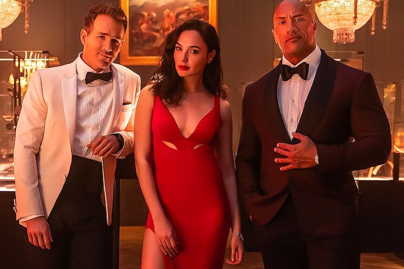 The Rock and Ryan Reynolds Join Forces To Hunt Down Gal Gadot in Netflix's 'Red Notice'