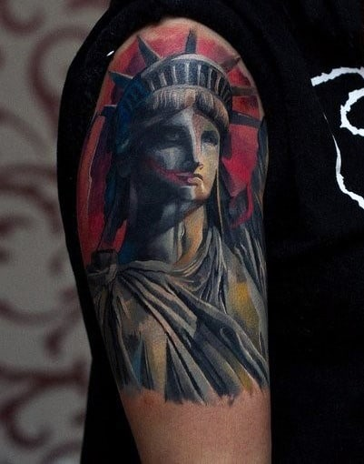 Red Upper Arm Statue Of Liberty Male Tattoos
