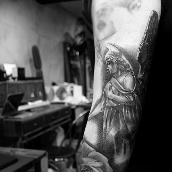 Remarkable Angel Statue Tattoos For Males On Tricep Back Of Arm
