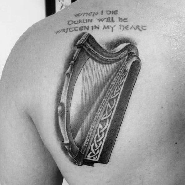 Remarkable Harp Tattoos For Males On Shoulder Blade