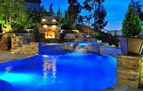 Resort Style Outdoor Fireplace With Pool And Built In Hot Tub