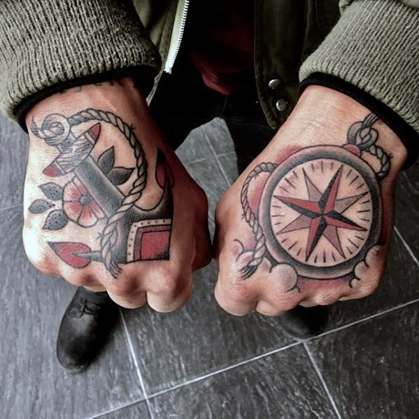 retro traditional mens small black and red ink anchor hand tattoo