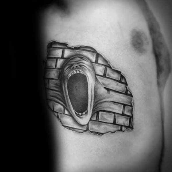 Rib Cage Side Brick In The Wall Pink Floyd Tattoo Design On Man