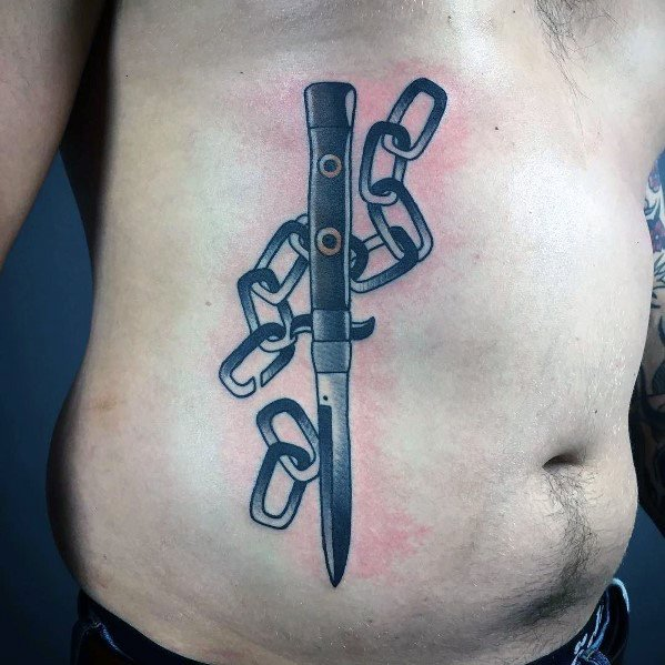 Rib Cage Side Chains With Switchblade Tattoo Ideas On Guys