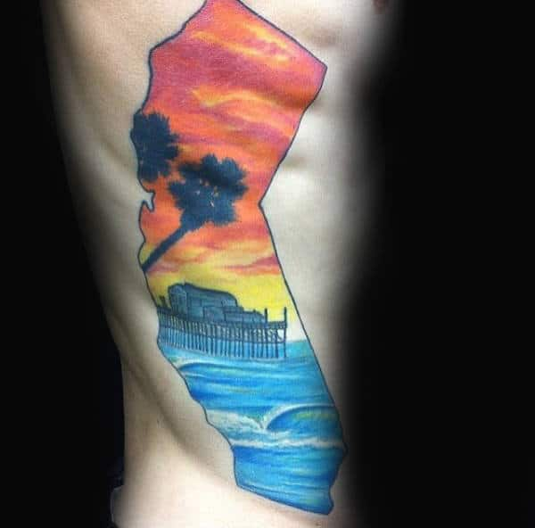 Rib Cage Side Guys California State With Colorful Sunset Ocean Waves Tattoo
