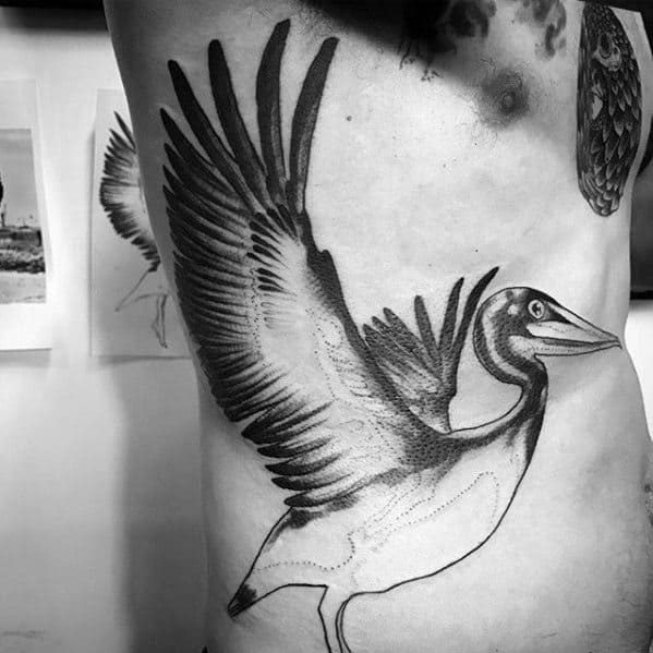 Rib Cage Side Of Body Creative Flying Pelican Tattoos For Men