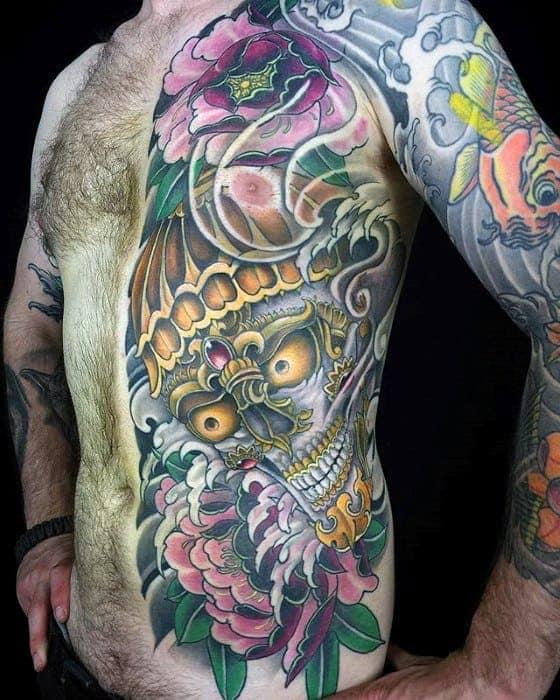 rib-cage-side-of-body-tibetan-skull-guys-tattoo-ideas