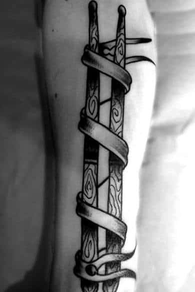 Ribbon Wrapped Around Wood Drum Sticks Forearm Guys Tattoos
