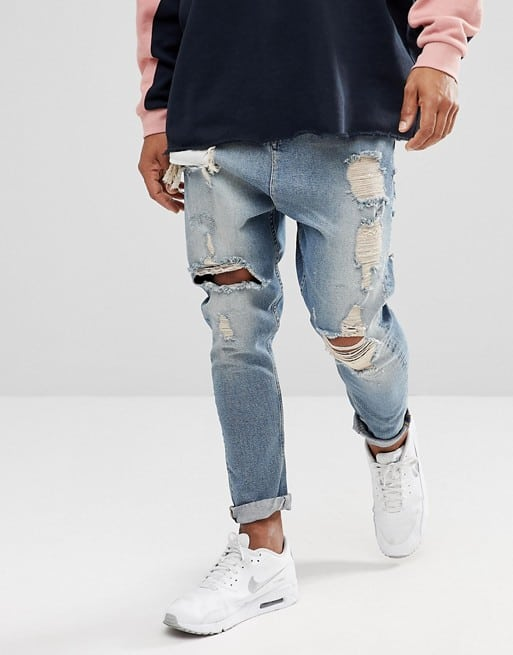 drop crotch jeans in vintage light wash blue with heavy rips