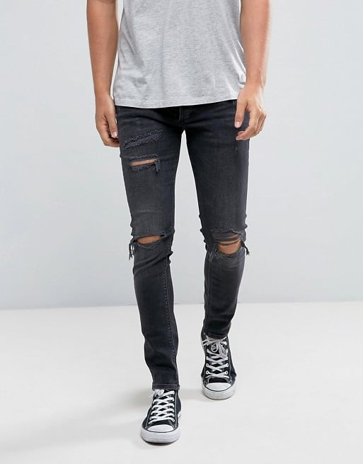 skinny jeans with rips in black wash