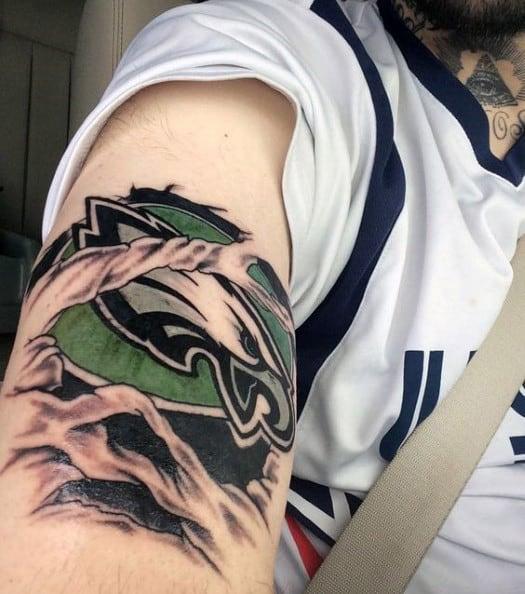 Ripped Skin Philiadephia Eagles Male Arm Tattoo
