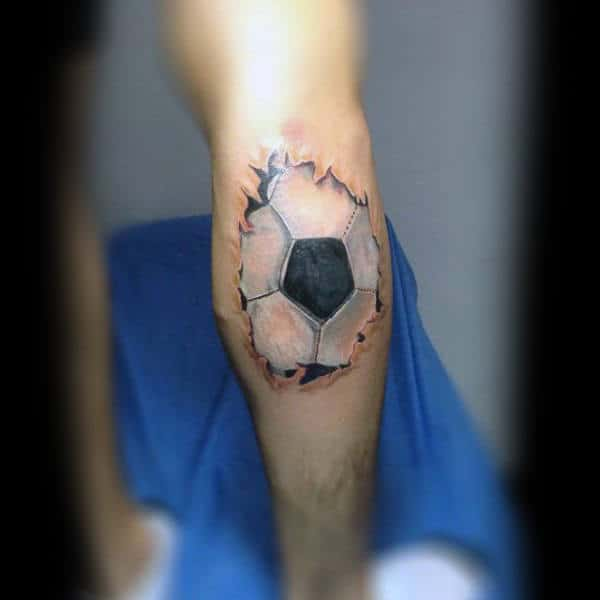 Ripped Skin Soccerball On Leg Calf Tattoo For Gentlemen