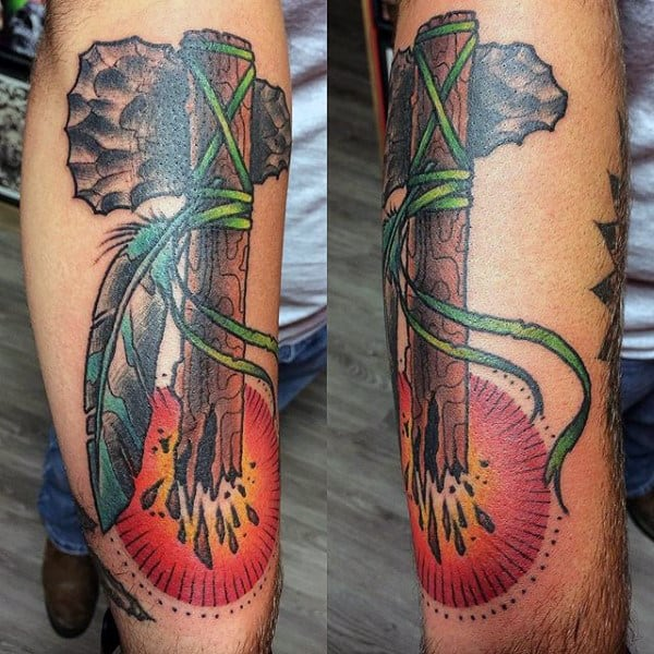 Rising Sun Broken Wood Tomahawk Tattoo With Feathers On Mans Arm