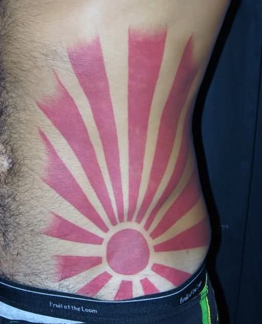 Rising Sun Red Ink Mens Lower Ribcage Tattos