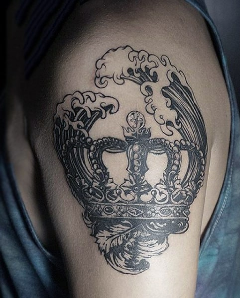 Roaring Waves And Crown Tattoo On Biceps Male