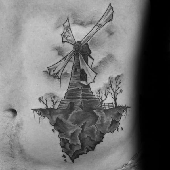 Rock Cliff With Windmill Guys Rib Cage Side Tattoo