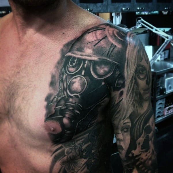 Roman Numeral Gas Mask Tattoo On Mans Shoulder