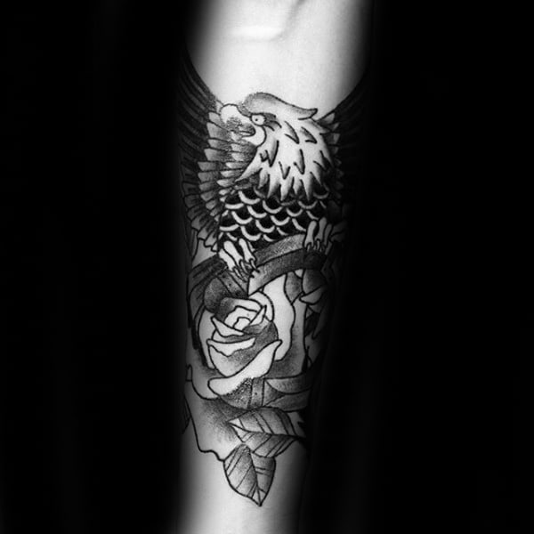 Rose Flower With Bald Eagle Carrying Horseshoe Mens Inner Forearm Tattoo