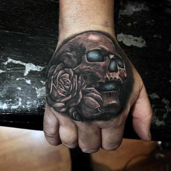 Rose Flower With Glowing Blue Skull Mens Hand Tattoo