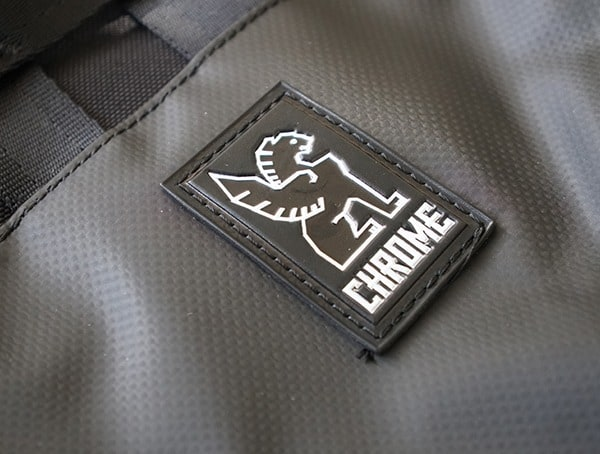 Rubber Chrome Industries Logo Badge On Mens Barrage Cargo Backpack