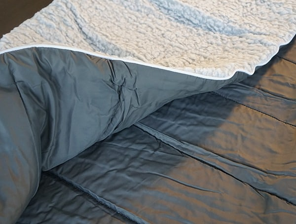Rumpl Puffy Sherpa Blanket With Nylon Fabric On Opposite Side