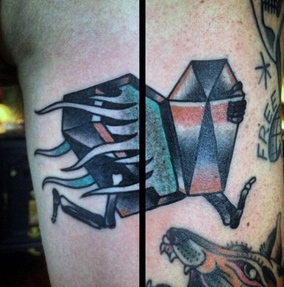 Running Coffin Tattoo Design On Mans Arm
