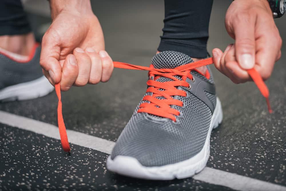 running footwear orange laces