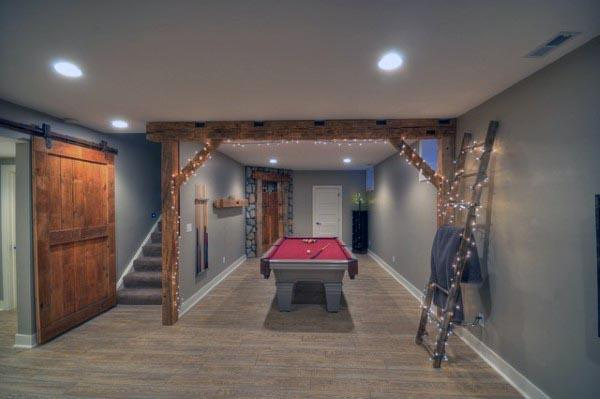Rustic Basement Lighting With Wood Beams