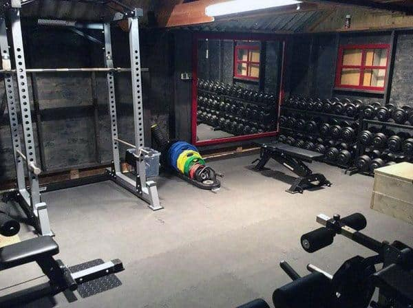 Rustic Man Cave Home Gym With Bench Press And Free Weights Rack