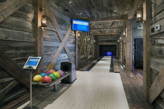 Rustic Wood Walls Bowling Alley In Home Basement