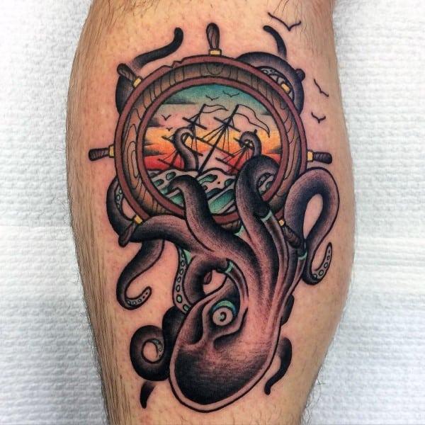 Sailing Ship Inside Wheel With Kraken Guys Leg Calf Tattoos
