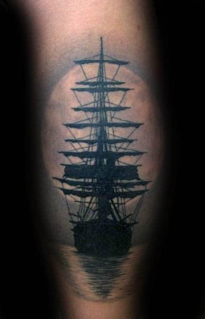 Sailing Ship Silhouette With Moon Mens Leg Calf Tattoo