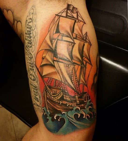 Sailing Ship Sun And Water Tattoos On Men