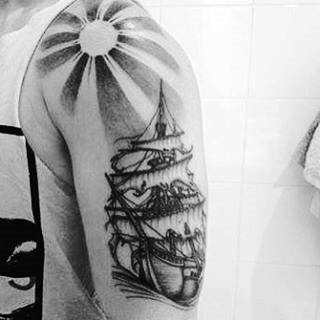 Sailing Ship Sun Ray Tattoo For Guys On Arm