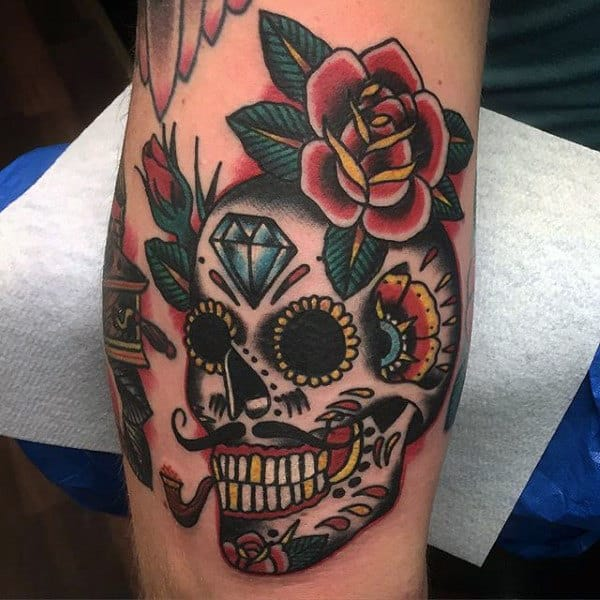 Sailor Jerry Style Creative Mens Sugar Skull Tattoo With Flowers On Inner Bicep Of Arm