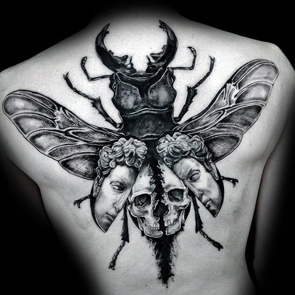 scarab bettle with skull and heads mens back tattoo