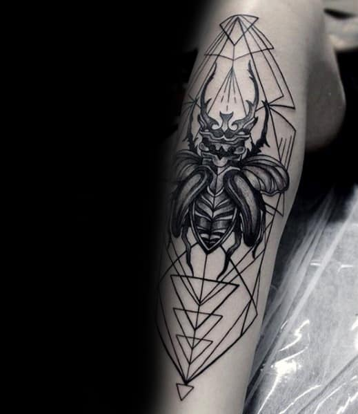 scarab tattoo for men on shin with geometric design